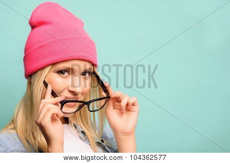 Cheerful girl standing on blue background