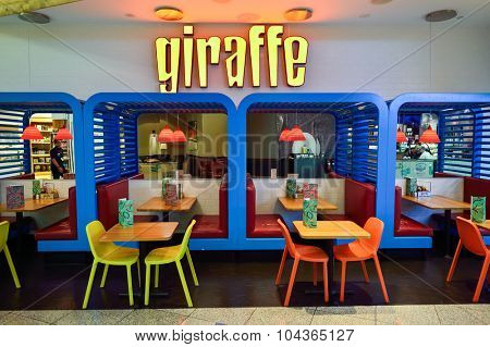 DUBAI, UAE - SEPTEMBER 08, 2015: Jiraffe cafe in Dubai Airport. There are a lot of restaurants, bars, cafes and shops in Dubai International Airport. Almost all of them are open twenty-four hours.