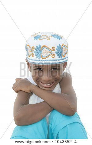Smiling boy wearing a traditional hat, five years old