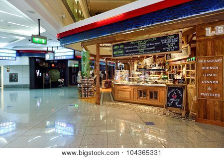 DUBAI, UAE - SEPTEMBER 08, 2015: restaurant in Dubai Airport. There are a lot of restaurants, bars, cafes and shops in Dubai International Airport. Almost all of them are open twenty-four hours.