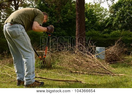 Yardwork bundling twigs