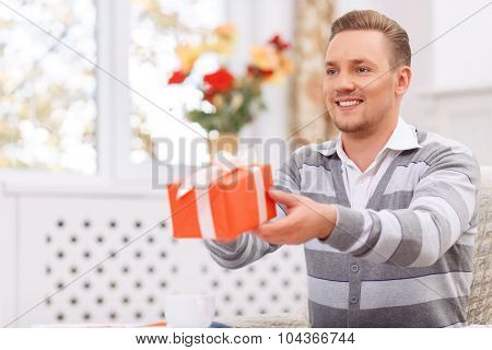 Pleasant man giving present