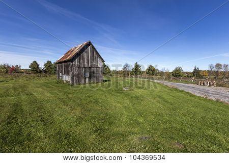 Decrepit barns in a field