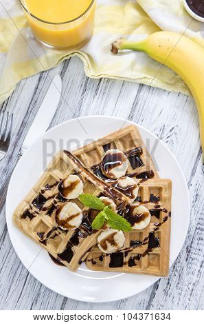 Waffles With Bananas And Chocolate Sauce