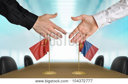 China and Mongolia diplomats agreeing on a deal