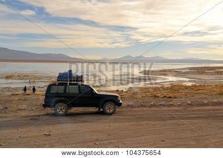 Tourist jeep at hot springs in Southwestern Bolivia near Uyuni