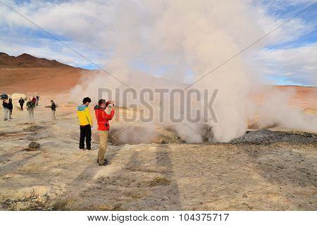 Tourists at a geysir in Southwestern Bolivia near Uyuni