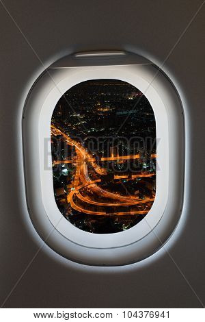 Airplane Window From Interior Of Aircraft With High Way View.