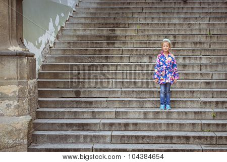 The girl on the stairs high in the District Mala Strana