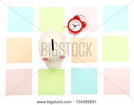 Piggy bank with stickers and alarm clock