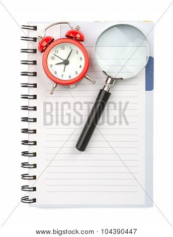Copybook with magnifier and alarm clock