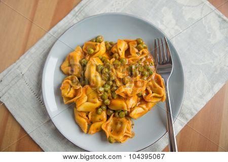 tortellini with peas on a plate