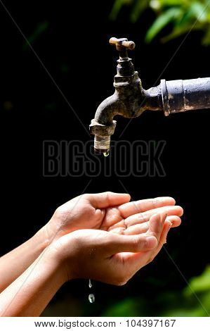 Little Hand Wait For Water Drop From Faucet