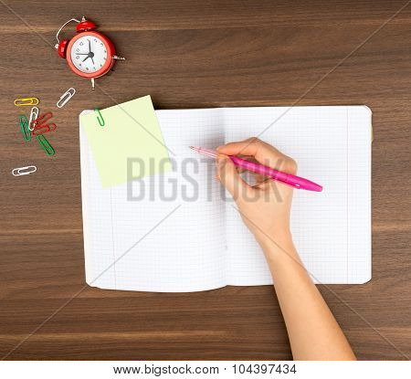 Humans writing hand on table