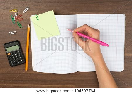 Humans writing hand on table with pencil
