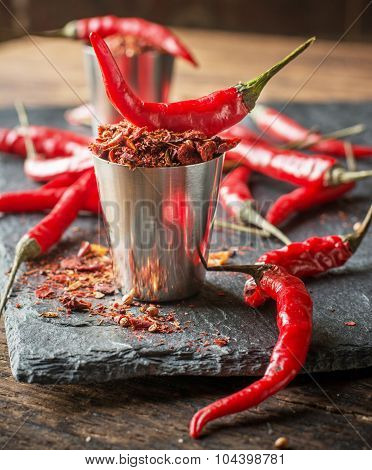 Vibrant red mexican hot chilli pepper, whole and grounded