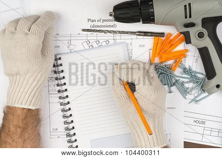 Man writing in copy book with drill