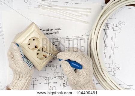 Mans hands fixing socket