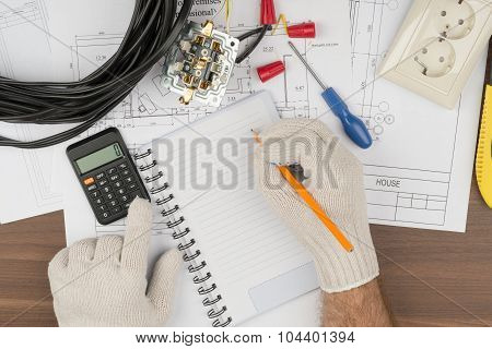 Man writing in copybook