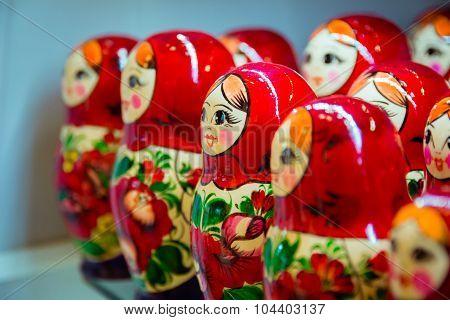Many red babushkas arranged in a row.