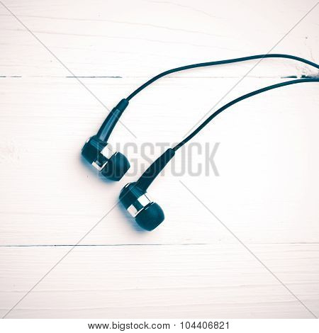earbuds over white table background vintage style