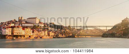 View of the historic city of Porto, Portugal with the Dom Luiz bridge.