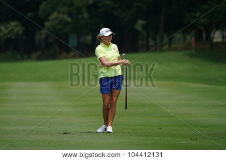 KUALA LUMPUR, MALAYSIA - OCTOBER 09, 2015: USA's Stacy Lewis watches her shot on the sixth hole fairway of the KL Golf & Country Club at the 2015 Sime Darby LPGA Malaysia golf tournament.