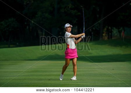 KUALA LUMPUR, MALAYSIA - OCTOBER 09, 2015: Australia's Minjee Lee reacts after her play from 6th hole fairway at the KL and Golf & Country Club at the 2015 Sime Darby LPGA Malaysia golf tournament.