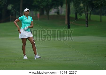 KUALA LUMPUR, MALAYSIA - OCTOBER 09, 2015: USA's Cheyenne Woods reacts after her shot on the sixth hole fairway of the KL Golf & Country Club at the 2015 Sime Darby LPGA Malaysia golf tournament.