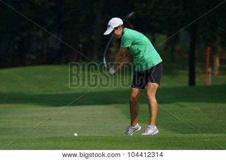 KUALA LUMPUR, MALAYSIA - OCTOBER 09, 2015: USA's Candice Kung plays from 6th hole fairway at the Kuala Lumpur Golf & Country Club at the 2015 Sime Darby LPGA Malaysia golf tournament.