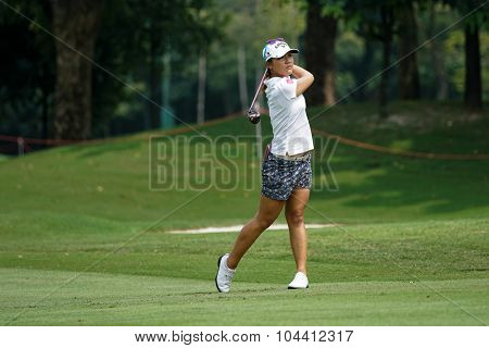KUALA LUMPUR, MALAYSIA - OCTOBER 09, 2015: New Zealand's Lydia Ko plays her shot on the sixth hole fairway of the Kuala Lumpur Golf & Country Club at the 2015 Sime Darby LPGA Malaysia golf tournament.