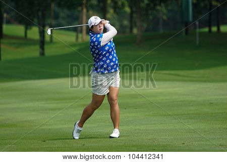 KUALA LUMPUR, MALAYSIA - OCTOBER 09, 2015: China's Shanshan Feng plays her shot from the sixth hole fairway of the KL Golf & Country Club at the 2015 Sime Darby LPGA Malaysia golf tournament.