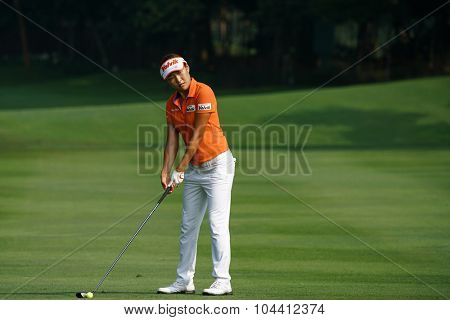 KUALA LUMPUR, MALAYSIA - OCTOBER 09, 2015: South Korea's Il Hee Lee plays from the fairway of the 6th hole of the Kuala Lumpur Golf & Country Club at the 2015 Sime Darby LPGA Malaysia golf tournament.