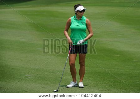 KUALA LUMPUR, MALAYSIA - OCTOBER 09, 2015: USA Gerina Piller plays from 6th hole fairway of the Kuala Lumpur Golf & Country Club at the 2015 Sime Darby LPGA Malaysia golf tournament.