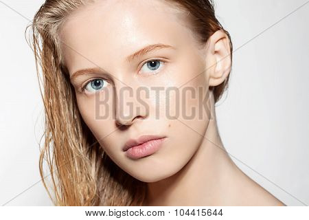 Close-up Of A Woman With Blonde Hair Wet Without Makeup