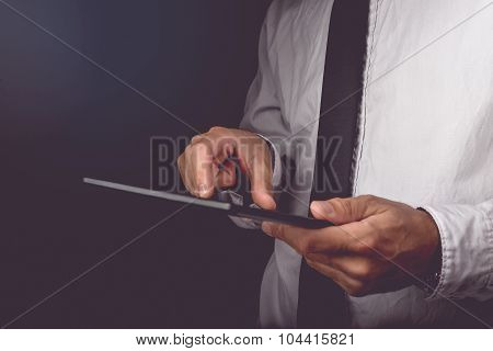 Businessman Working On Digital Tablet Computer