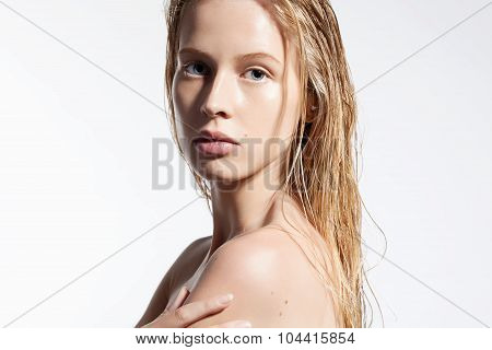 Woman With Pure Skin And Wet Hair After A Shower