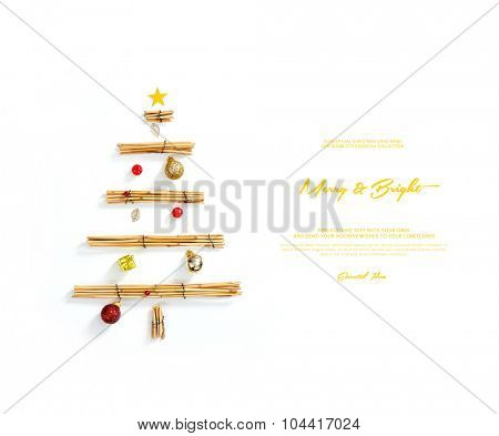 conceptual christmas card , shows an image of a christmas synthesis made with reed and toy christmas decorations