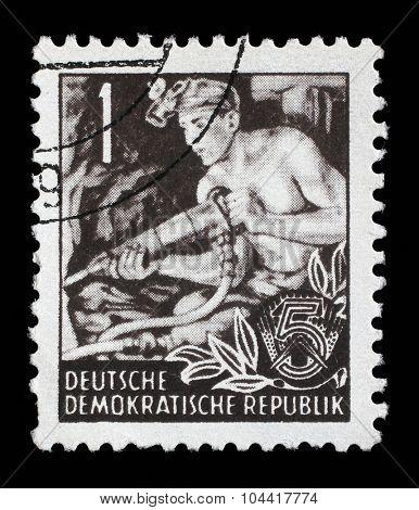 GDR - CIRCA 1953: A stamp printed in GDR (German Democratic Republic - East Germany) shows a Hauer without the inscription, from the series Workers For The Five-year Plan, circa 1953