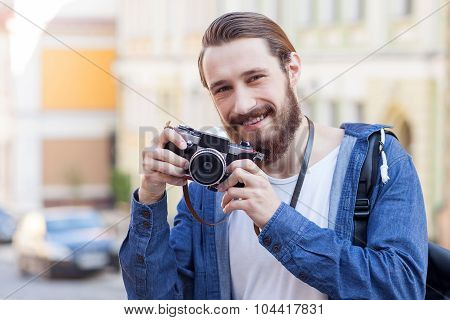 Attractive young man is traveling and making photos