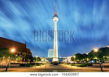 Night View Of Fernsehturm With Neptun Fountain In Berlin.