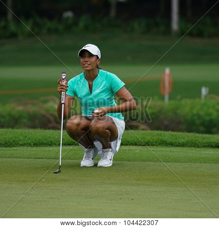 KUALA LUMPUR, MALAYSIA - OCTOBER 09, 2015: USA's Cheyenne Woods prepares to putt from the 18th hole green at the KL Golf & Country Club at the 2015 Sime Darby LPGA Malaysia golf tournament.