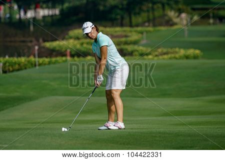 KUALA LUMPUR, MALAYSIA - OCTOBER 09, 2015: France's Karine Ischer prepares to hit from the 6th hole fairway at the KL Golf & Country Club at the 2015 Sime Darby LPGA Malaysia golf tournament.