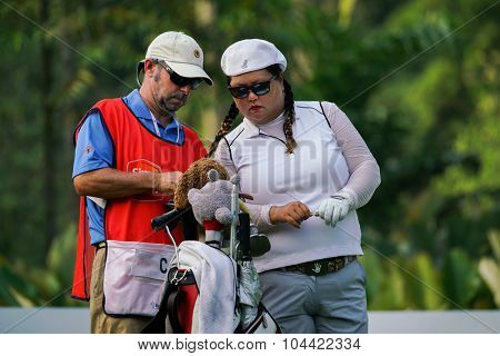 KUALA LUMPUR, MALAYSIA - OCTOBER 09, 2015: USA's Christina Kim discusses with her caddy at the KL Golf & Country Club at the 2015 Sime Darby LPGA Malaysia golf tournament.