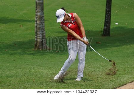 KUALA LUMPUR, MALAYSIA - OCTOBER 09, 2015: South Korea's Sei Young Kim hits from outside the 18th hole green at the KL Golf & Country Club at the 2015 Sime Darby LPGA Malaysia golf tournament.