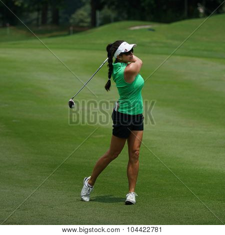 KUALA LUMPUR, MALAYSIA - OCTOBER 09, 2015: USA's Gerina Piller watches the ball from the 6th hole fairway at the KL Golf & Country Club at the 2015 Sime Darby LPGA Malaysia golf tournament.