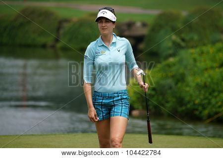 KUALA LUMPUR, MALAYSIA - OCTOBER 09, 2015: Germany's Sandra Gal walks to the 18th hole green at the KL Golf & Country Club at the 2015 Sime Darby LPGA Malaysia golf tournament.