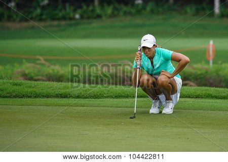 KUALA LUMPUR, MALAYSIA - OCTOBER 09, 2015: USA's Cheyenne Woods lines her putt at the 18th hole green at the KL Golf & Country Club at the 2015 Sime Darby LPGA Malaysia golf tournament.