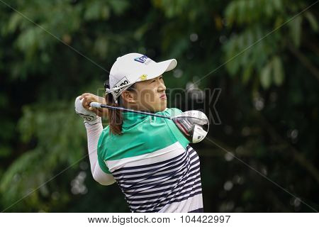 KUALA LUMPUR, MALAYSIA - OCTOBER 10, 2015: South Korea's Amy Yang tees off at the sixth hole of the KL Golf & Country Club on Round 3 day at the 2015 Sime Darby LPGA Malaysia golf tournament.
