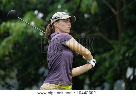 KUALA LUMPUR, MALAYSIA - OCTOBER 10, 2015: France's Karine Ischer tees off at the sixth hole of the KL Golf & Country Club on Round 3 day at the 2015 Sime Darby LPGA Malaysia golf tournament.